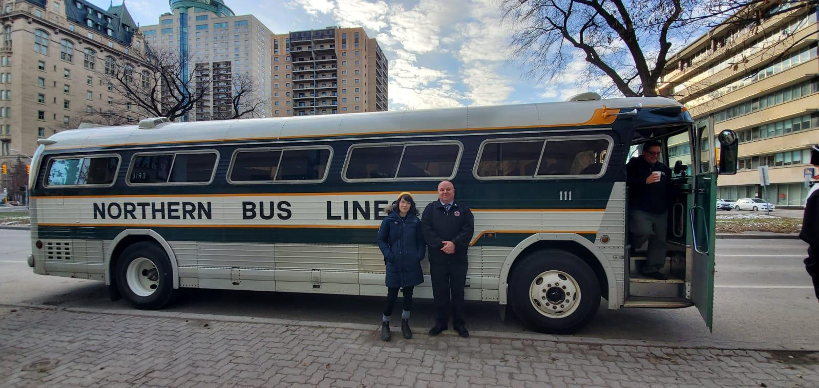 Emily and John infront of Greyhound Bus
